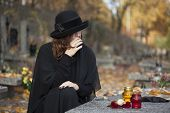 Grieving Woman At Graveyard