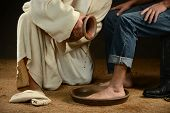 stock photo of gospel  - Jesus washing feet of modern man wearing jeans - JPG