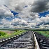 dramatic sky and railroad to horizon