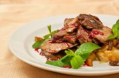 stock photo of duck breast  - Roasted sliced duck on dish in restaurant - JPG