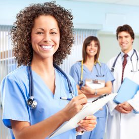 stock photo of nursing  - Smiling medical people with stethoscopes - JPG