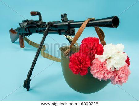 Metralhadora e flores