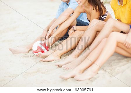 summer, holidays, vacation and happy people concept - close up of teenager friends or volleyball team having fun on the beach