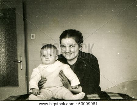 SZCZECINEK, POLAND, CIRCA 1950's: Vintage photo of mother with little daughter
