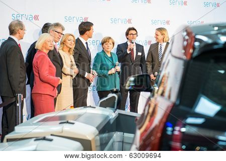 HANOVER, GERMANY - APRIL 7: German Chancellor Angela Merkel during a technology showcase tour of innovations in industrial Robotics used in the Automotive industry. Hannover Messe, 7 April 2014