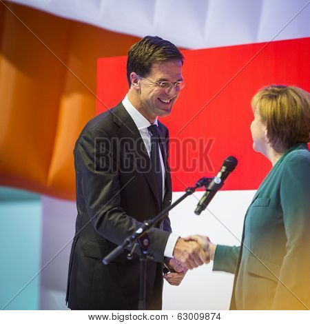 HANOVER, GERMANY - APRIL 7:  Dutch Prime Minister Mark Rutte and German Chancellor Angela Merkel opening the Hannover Messe. April 7, 2014.
