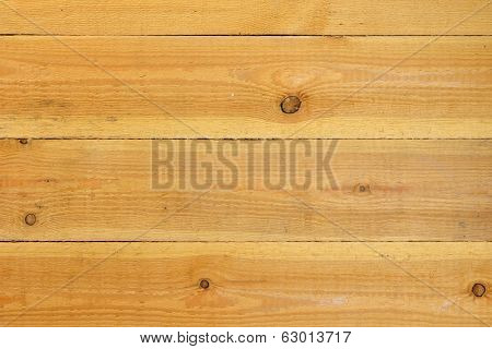 Surface unprocessed wooden planks