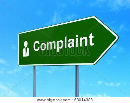 Law concept: Complaint and Business Man on road sign background
