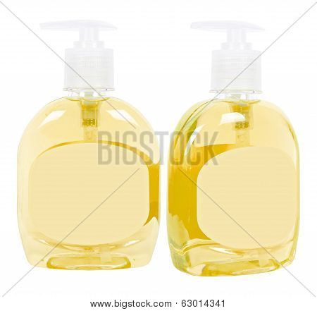 Yellow Bottles With Liquid Soap