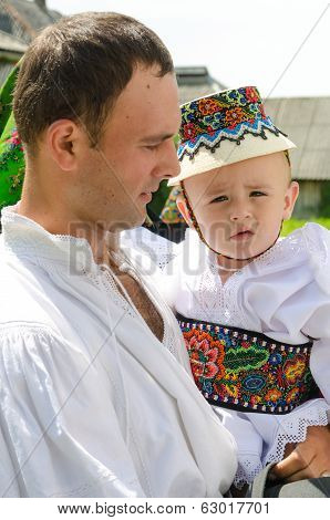 Father and son wearing traditional clothing