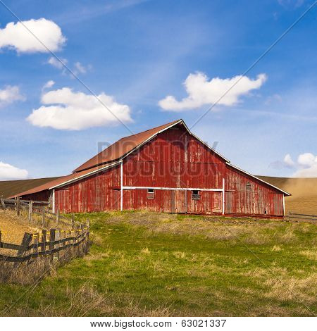 Bright Red Barn On Clear Day.