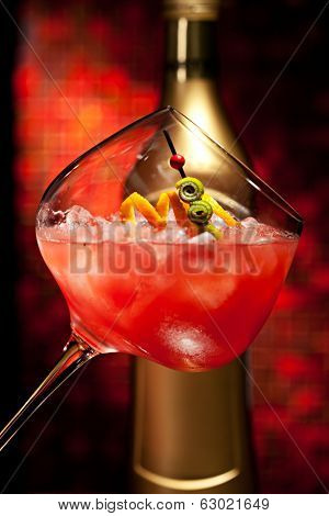 Red Cocktail with Vodka, Orange Juice, Berries and Liquor