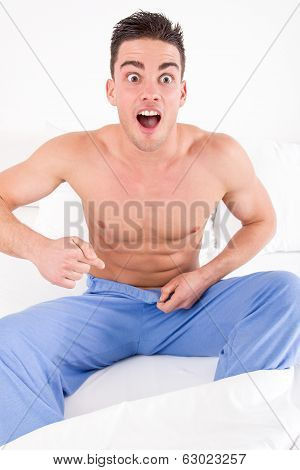 Handsome Half Naked Man Having Problems With Genitals And Potency