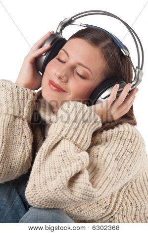 Portrait Of Happy Woman Enjoying Music With Headphones