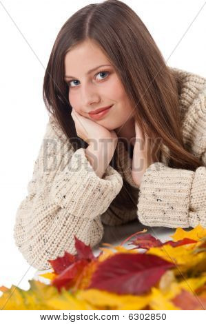 Autumn Portrait Of Beautiful Woman With Leaf Wearing Turtleneck