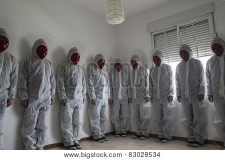 Nightmare concept, man with white dress and red mask