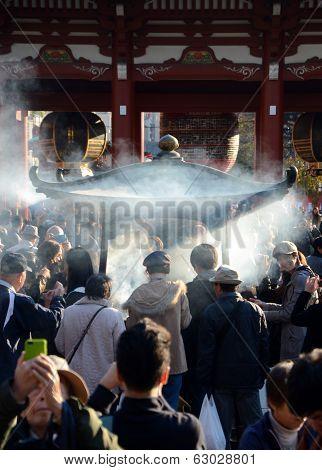 Tokyo, Japan - Nov 21: Buddhists Gather Around A Fire To Light Incense And Pray At Sensoji Temple