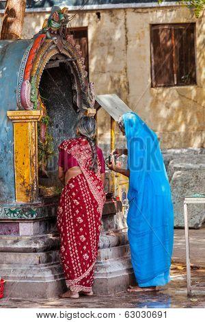MADURAI, INDIA - FEBRUARY 16, 2013: Unidentified Indian women worship Hindu god Ganesh in famous Meenakshi Amman Temple - historic Hindu temple located in temple city Madurai