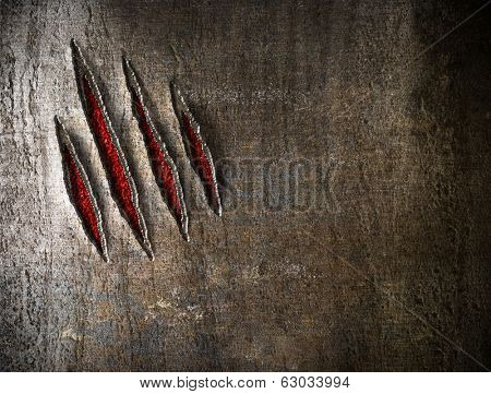 claw scratches on metal wall background