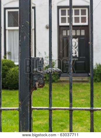 Black Iron Gate With Rusty Lock