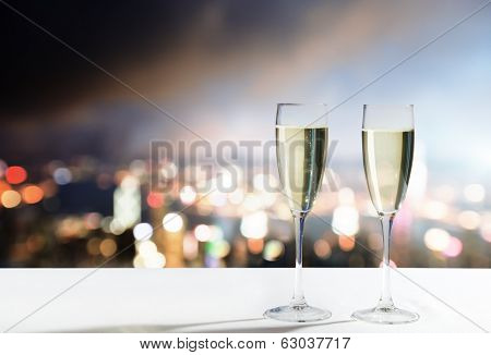 champagne Glasses and night city