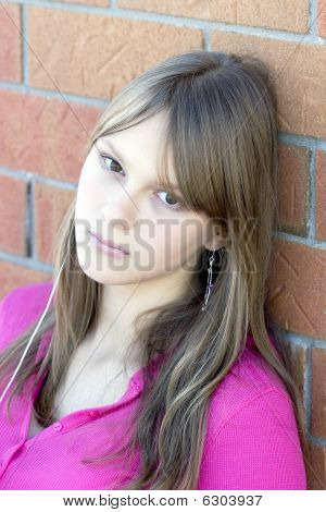 Portrait of a young beautiful teenager girl wearing headphones listening music