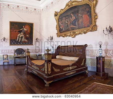 Mafra, Portugal - September 02, 2013: Kings Bedroom. Neoclassical bed and furniture. Mafra National Palace. Baroque architecture.