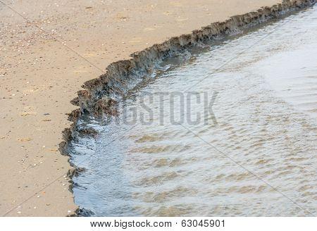 Disintegrating Sand On The Beach