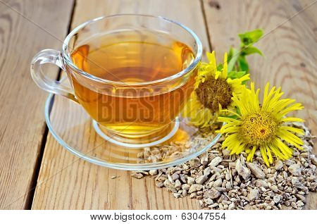 Herbal Tea From Root Of Elecampane With Flower On Board
