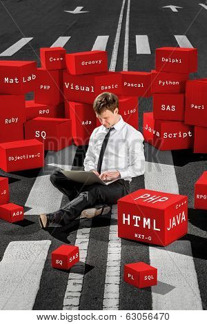 Programmer Sitting And Working With Laptop On The Asphalt Road Surrounded With Red Boxes With Differ