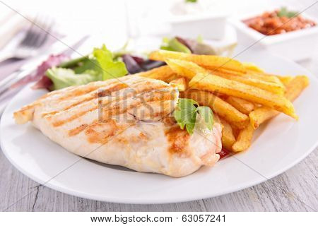 grilled chicken breast and fries