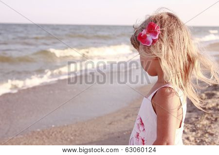Little Girl Playing On The Sea Shore