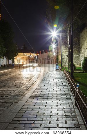 Old street with paving stones and wall