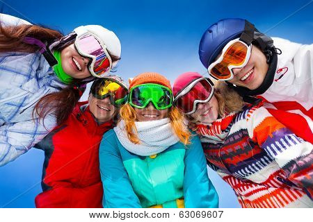 Five happy friends wearing goggles