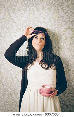 Pensive And Suspecting Woman On Retro Wall With Coffee