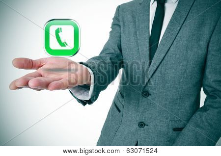 a businessman with a telephone icon in his hand depicting the voice-over-IP apps