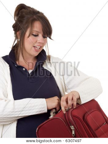 Young woman with luggage; isolated on a white background.