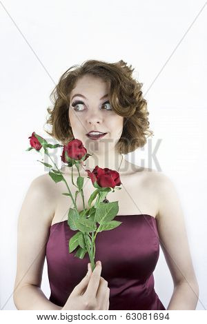 Pretty young woman with red roses