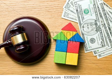 the wooden house with money and judge gavel