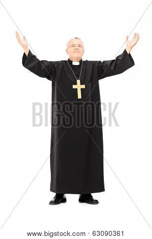 Full length portrait of mature priest with his hands in the air isolated on white background