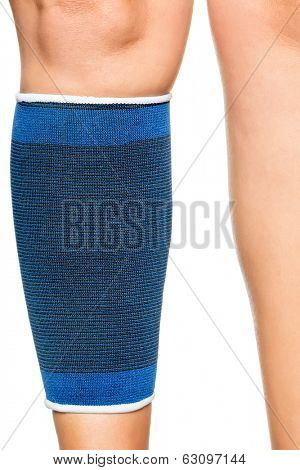 Detail of a young woman with an elastic band on her leg isolated on white