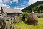 picture of farmhouse  - Traditional wooden farmhouse near a river in Transylvania - JPG