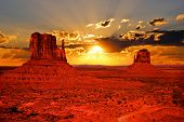 stock photo of butts  - Beautiful sunrise over iconic Monument Valley - JPG