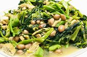 image of groundnut  - Closeup morning glory and spinach fried with tofu groundnut and Champignon mushroom - JPG