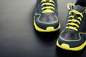 foto of relay  - Sport shoes on grey background - JPG