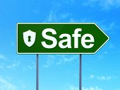 Safety concept: Safe and Shield With Keyhole on road sign background