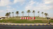 stock photo of bahrain  - Bahrain sign in a roundabout - JPG
