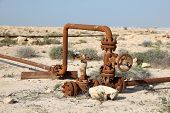 stock photo of bahrain  - Rusty oil pipes in the desert of Bahrain - JPG