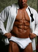 stock photo of strip tease  - buff male in tux wide open lots of muscle - JPG