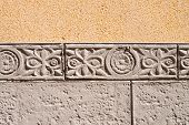 picture of tile cladding  - Ornamental wall cladding using granite bricks with floral motives - JPG
